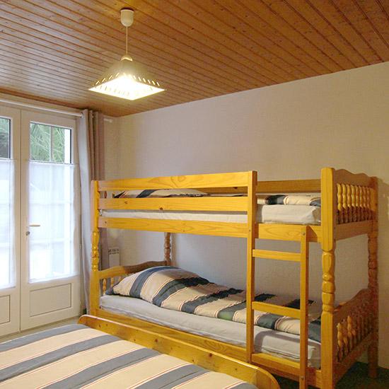 Chambre familiale avec lits superposés